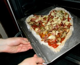 Place the pizza in the oven.