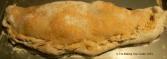 Golden-brown, finished calzone.